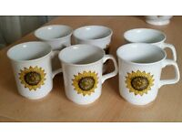 6 small ceramic coffee cups. In good condition.