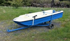 Boat (Dory style) and trailer for sale with rod holders, oars and rollocks (No trailer board)