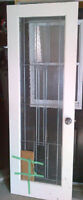 Pantry door with antique nickel caming and rain glass