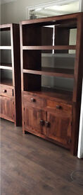 Dark wood bookcase with built in drawers and cupboards