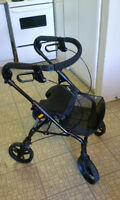 Brand new high quality black and blue walker with front basket.