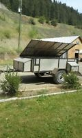 10x7 utility trailer with flip-up tonneau cover  $1,400