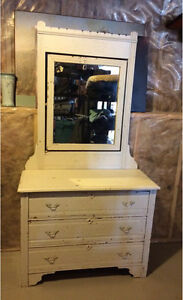 Antique solid wood dresser with mirror.