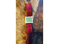 Retro square faced watch with ted suede strap.