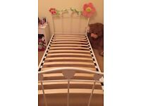 Single white metal bed frame