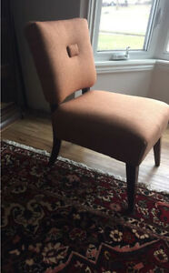 Mid century reupholstered burnt orange chair