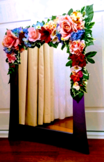 Mirror with artificial flowers