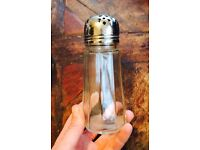 Lovely glass silver topped sugar shaker.