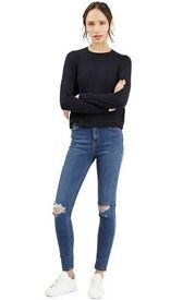 Ripped knees jeans sizes 6, 8, 10, 12 and 14.