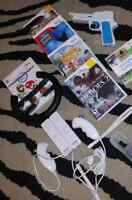 Wii Console Bundle, 2 Controllers, 2 Nunchuks, and 6 Games
