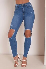 Blue ripped knee jeans