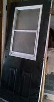 Exterior door with opening screen window - painted black