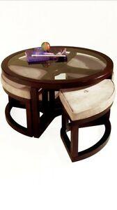 Round glass top coffee table with 4 ottomans