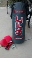 UFC Punching Bag 70lbs with straps, bolts and gloves