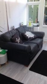 2 seater black leather sofa...SOLD