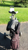 Complete set of golf clubs with bag and cart