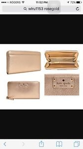 Beige zip up Kate spade wristlet/clutch brand new with tag