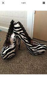 Zebra pattern shoes size 4
