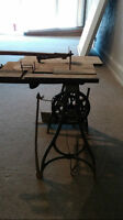 antique mounted table saw with foot treadle