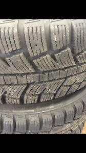In new condition winter tires & rims