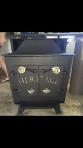 Selling Great Condition Cast-Iron Wood Stove + Piping $800 obo