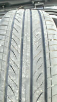Four 195-65-R15 tires on rims with hubcaps in like-new condition