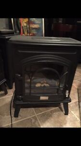 Small black electric fireplace heater - open space or room