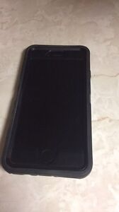 iPhone 6 phone with case and new EarPods