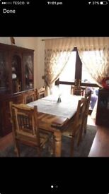 Dining table with 6 chairs .