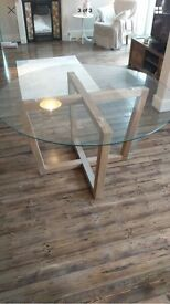 Round glass and oak dining table