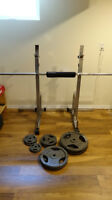 Bench press/squat rack with barbell