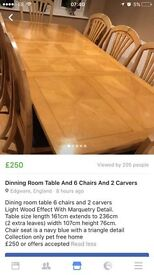 Dining room table with 6 chairs and 2 carvers