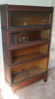 Antique Sectional Glass front bookcase.