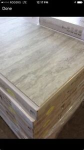 8 BRAND NEW boxes of pearl grey laminate tile flooring