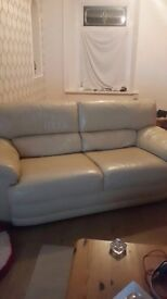 Two chairs and a three seater sofa