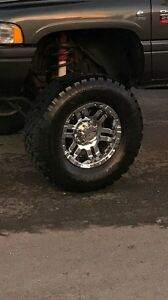 "Brand new 17"" rims 8 bolt with brand new 35"" tires"