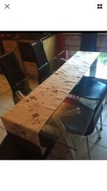 Stunning glass dining room table and 6 chairs