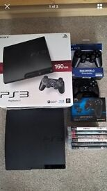 PS3 Slim 160GB + two controllers and 6 games.