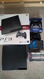 PS3 slim 160 GB + 2 controllers + 6 top games. Great condition!