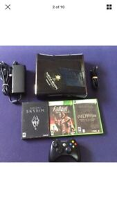 Xbox 360 slim console with games.