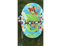 Bright starts baby seat with toy bar