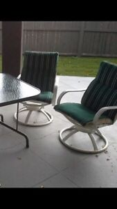 Patio Chairs- Set of 4.  All swivel & rock.