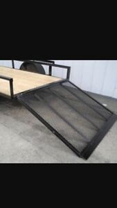 Utility trailer with fold-down ramp
