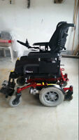 electric wheelchair, has a lift chair  in it..