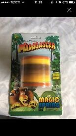 Novelty slinky toy (Stocking filler Xmas madagascar home dragon)