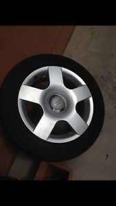 Audi A4 - 4 Rims + 4 All season Tires 60% Tread all for $350 London Ontario image 1