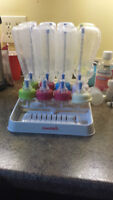 baby bottles and drying rack for sale