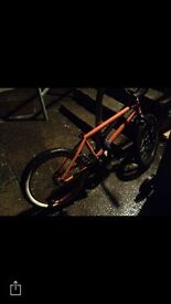 Bmx orange with black bars and black forks