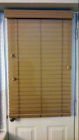 Faux wood blind for a door