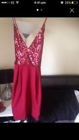 Red sparkly dress new with tags size 8.